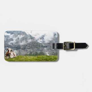 A lonesome cow in the Swiss Alps Luggage Tag