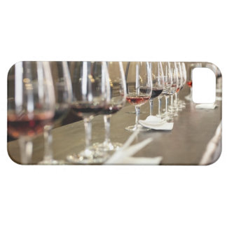 A long row of wine glasses set up so a large barely there iPhone 5 case
