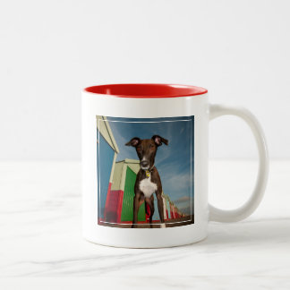 A Lurcher Standing In Front Of Some Beach Huts Two-Tone Coffee Mug