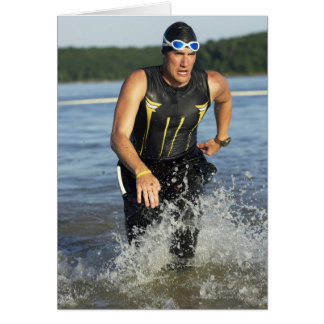 A male athelete running out of the water while 2 greeting card