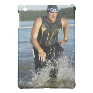 A male athelete running out of the water while 2 iPad mini covers