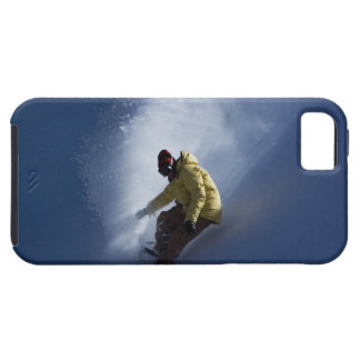 A male snowboarder catches last light on a iPhone 5 cases