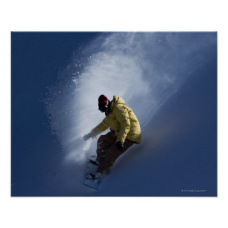 A male snowboarder catches last light on a poster