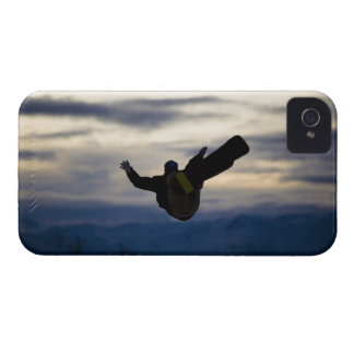 A male snowboarder does a back flip while riding iPhone 4 covers