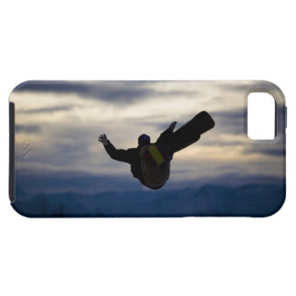 A male snowboarder does a back flip while riding iPhone 5 cases