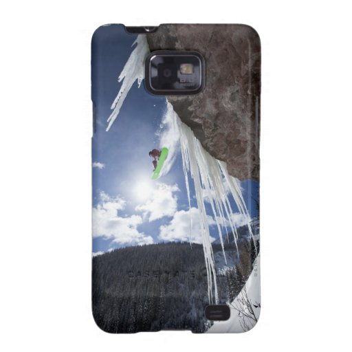 A male snowboarder jumps off an ice waterfall samsung galaxy cases