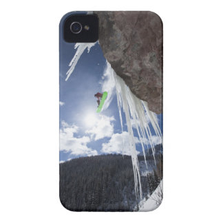 A male snowboarder jumps off an ice waterfall iPhone 4 cover