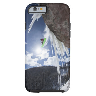 A male snowboarder jumps off an ice waterfall tough iPhone 6 case