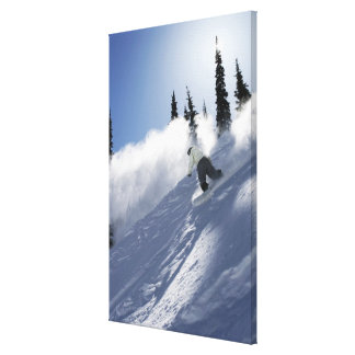 A male snowboarder ripping powder in Idaho. Canvas Print