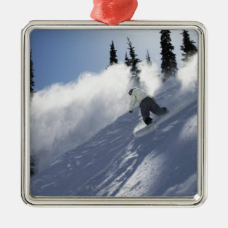 A male snowboarder ripping powder in Idaho. Christmas Ornament