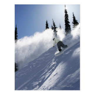 A male snowboarder ripping powder in Idaho. Postcard