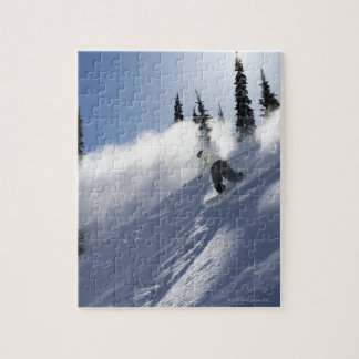 A male snowboarder ripping powder in Idaho. Puzzle