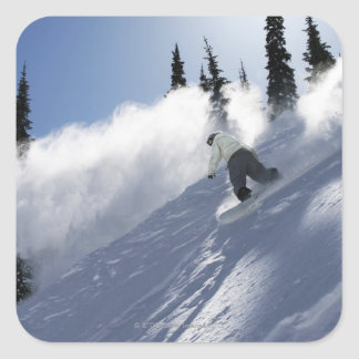 A male snowboarder ripping powder in Idaho. Square Sticker