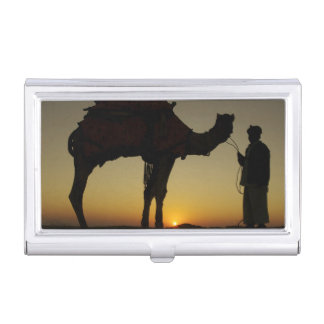 a man and his camel Silhouetted at sunset on the Business Card Holder