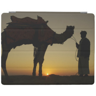 a man and his camel Silhouetted at sunset on the iPad Cover