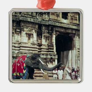 A man being blessed by an elephant christmas ornament