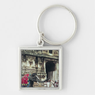 A man being blessed by an elephant key chain