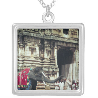 A man being blessed by an elephant silver plated necklace
