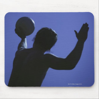 A man with a volleyball mouse mat