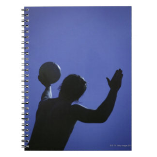 A man with a volleyball notebook