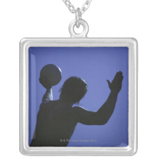 A man with a volleyball silver plated necklace