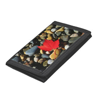 A Maple leaf on a Rock Background Tri-fold Wallets