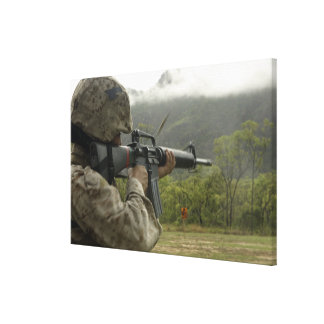 A Marine conducts drills Canvas Print