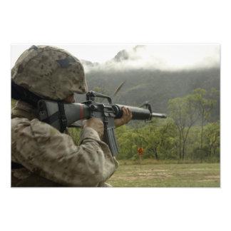 A Marine conducts drills Photo Print