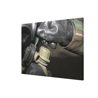 A Marine inserts a drinking tube into his cante Canvas Print