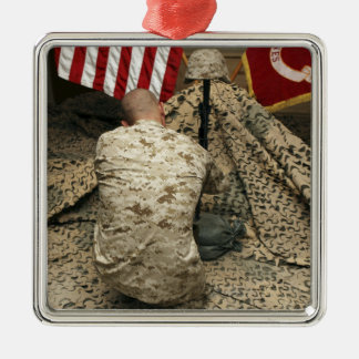 A marine kneels before the rifle christmas ornament