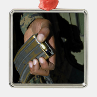 A Marine loads blank ammunition rounds Christmas Ornament