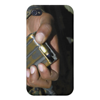 A Marine loads blank ammunition rounds iPhone 4 Case