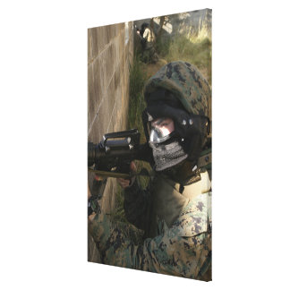 A Marine provides security Canvas Print