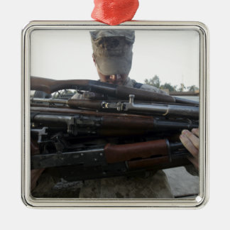 A marine readies 80 pounds of enemy rifles seiz Silver-Colored square decoration