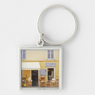 A market street in the old town with a shop Silver-Colored square key ring