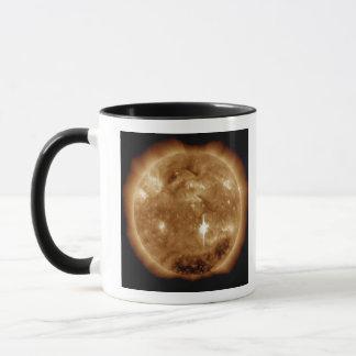 A massive X-class solar flare erupts on the Sun Mug