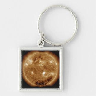 A massive X-class solar flare erupts on the Sun Silver-Colored Square Key Ring