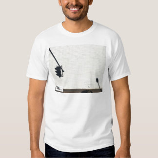 A meter makes a move on a stop light. shirt