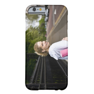 A mid adult woman carrying a yoga mat, walking barely there iPhone 6 case