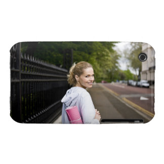 A mid adult woman carrying a yoga mat, walking iPhone 3 Case-Mate cases