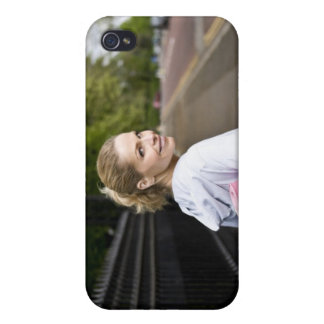 A mid adult woman carrying a yoga mat, walking iPhone 4 covers