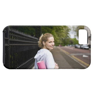 A mid adult woman carrying a yoga mat, walking iPhone 5 cover