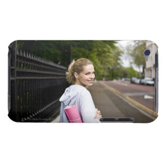 A mid adult woman carrying a yoga mat, walking iPod Case-Mate cases