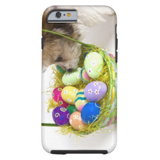 A mixed breed puppy sniffing at an Easter basket Tough iPhone 6 Case