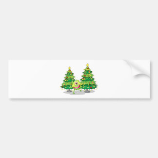 A monster dancing in front of the christmas trees bumper sticker
