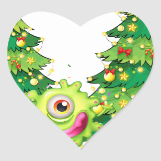 A monster dancing in front of the christmas trees heart sticker