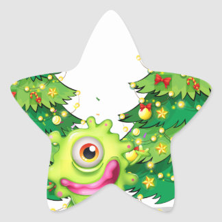 A monster dancing in front of the christmas trees star sticker