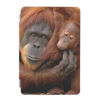 A mother and baby orangutan share a hug. iPad mini cover