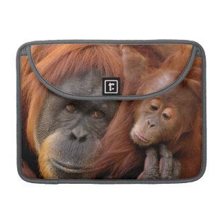A mother and baby orangutan share a hug. sleeve for MacBook pro