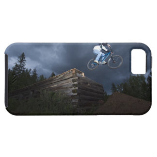 A mountain biker jumps off a log cabin in Idaho. iPhone 5 Cover